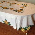 Classic and elegant Gold Poinsettia appliqué on easy care polyester is very economically priced.