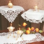 Battenburg Lace round doilies is hand made with satin stitched flower accents.