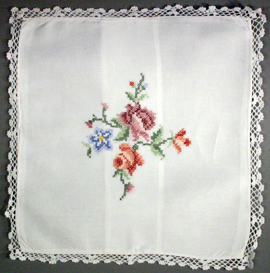 Cross stitched Roses cushion cover with full crochet lace edge