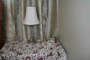 Solid Battenburg Lace square tablecloth can magically turn an ordinary bedside table into an elegant showpiece.