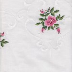 Hemstitched Rose in Rose colour on refreshing crisp white cotton with folded border.