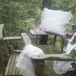 Cluny Lace Euro size cushions is a romantic backdrop for relaxing in cottages or backyard decks.