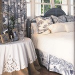 Cutwork tablecloth matching duvet cover can create a designer's coordinated element.