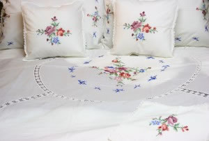 Cross Stitched Embroidered with crochet lace inserts bedding ensemble