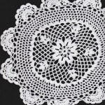 Hand Crocheted doily with Scalloped edging.