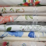 Hand appliqué cotton rich tablecloths available in different colour schemes