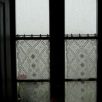 lace-curtains-adorn-the-window-of-a-tuscan-villa-in-the-rain-tuscany-italy.jpg