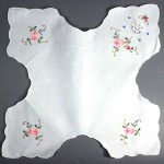 Hand appliqué bun cover with cross stitched embrodery and crochet lace insert is bright and cheerful. Available in White or cream