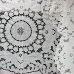 Lotus Blossoms: a very elaborate bed cover with cutwork embroidered lotus blossoms throughout the entire bed cover and sunflower motif in the centre.