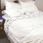 Hand knotted Modano Tuscan Lace rose motif embellished with Embroidered Roses Bed Cover & Skirt in Pristine White Cotton.
