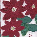 Classic and elegant Cranberry Poinsettia appliqué on easy care polyester is very economically priced.