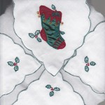 Green Appliqué motif Flip Bun Warmer - Toast Cover adds a finishing touch to a festive table setting during the holidays.