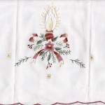 Beautifully embroidered Candlelight with Holly branches & ribbon on white cotton is a budget wise decoration for the entire holiday season