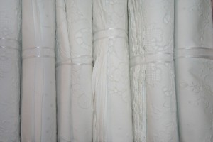 White Cotton hand embroidered sheet and matching pillow cases is luxury and intimacy.