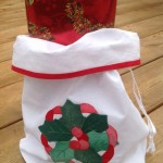 The Appliqué stitches of this Holly Wreath Gift Bag are so even & minute that only an expert embroiderer can master, an incredible 18-20 stitches per inch. With a wide bottomed gusset, It can even hold a bottle of Wine.