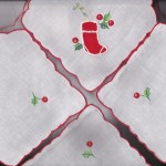 Red Appliqué motif Flip Bun Warmer - Toast Cover adds a playful finishing touch to a kid's table setting during the holidays.