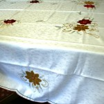 Classic and elegant Red & Gold Poinsettias appliqué on White Embossed fabric is very economically priced.