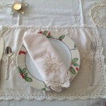 Touch of Gold tablecloths & Doilies features beautifully embroidered Candles with gold thread embroidered Ribbons & Hearts on Ecru easy care Viscose & Polyester blend. Full hand crocheted lace edge.