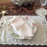 Touch of Gold Plate setting on easy care Viscose & Polyester blend classical Gold Thread embroidery with hand crocheted lace edge in a warm Ecru colour. Complete with coasters place mats & Napkins.