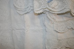 Hand knotted Modano Tuscan Lace embellished with Embroidered chrysanthemums Cushion Cover in Pristine White Cotton.