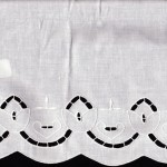 Natural Fibre Cotton Rich Cutwork Embroidery of Tulips all along the edge. White Colour.