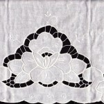 "The Water Lily-captured in embroidery with Cutwork details on Natural Fibre Cotton rich pillow cases. Generous size with 4"" tongue. White Embroidery on White. Queen size."