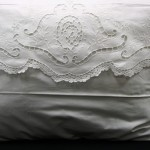 An exquisite Crisp White Cotton rich pillow case in envelope style. Beautiful Cutwork embroidered details with a very fine hand crocheted full lace edge. Standard size only.