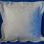 Heirloom Appenzell needle embroidery on Buratto needlework grid pillow cover.