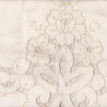 Pure Cotton cutwork rose motif pillow with cutwork trim edge.