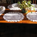 Hand crocheted Flower Wheel oval lace place mat with rosette edging