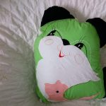 Apple Green CAT quillow with line drawing embroidery and zipper closure.