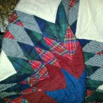 Hand quilted Tartan Lone Star in Ecru Cotton Flannel, available in a lap quilt or throw size.