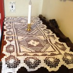 Ecru Tuscany Lace runner sets the tone for intimacy and elegance.