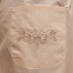 Retro Apron 1950 Style close-up view to illustrate Embroidery details.