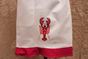 By the Sea: a whimsical apron for the kitchen! embroider red lobster. The Red and White Polka Dots edging adds a fun-loving humour.