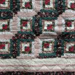 Traditional patchwork Log Cabin quilt with hand quilting. Cotton fabric with polyester filling. One size only. Limited quantity.