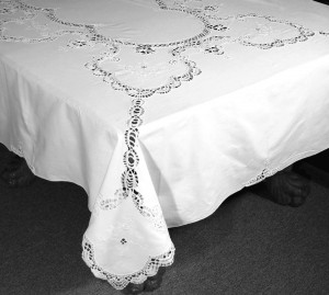 A Touch of Cluny Lace is simple elegance with hand embroidered heart shaped flower accent cotton tablecloth.