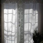 Battenburg Lace Peonies decorated along the full length of this crisp white cotton curtain set...even the tie-backs.