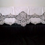 Ecru Battenburg lace Window Pane style valance as a sofa back cover,