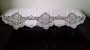 Ecru Battenburg lace Window Pane style valance as a sofa back cover,