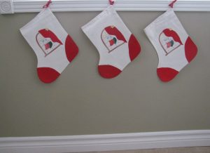 Vintage Cheerful Appliqué stocking. Hand stitched by master, an incredible 18-20 stitches per inch.