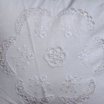 Ring a Ring o' Roses in tatting lace and hand stitched bouquet of roses white cotton throw pillow.