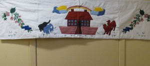 Hand quilted valance of the Ark to match the throw.