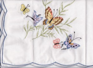 Butterflies are embroidered on cotton & polyester blend kitchen size table for 6.