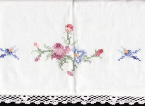Cross-stitched and fine Crochet Lace trimmed pillow sham