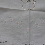 """Whitework embroider rose buds with a hint of colours. 24"""" square."""