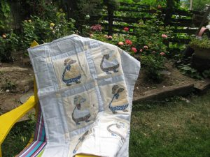Sun Bonnet Sue or Dutch Girl baby quilt with embroidered