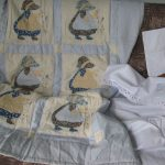 Sun Bonnet Sue or Dutch Girl baby quilt with embroidered details
