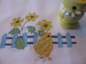 Picket Fence with Contour Embroidered Chicks and Sunflowers guest towels as place mats for Easter family dinner.