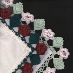 Grandma's handkie with Irish Roses crocheted lace along the trim edge.